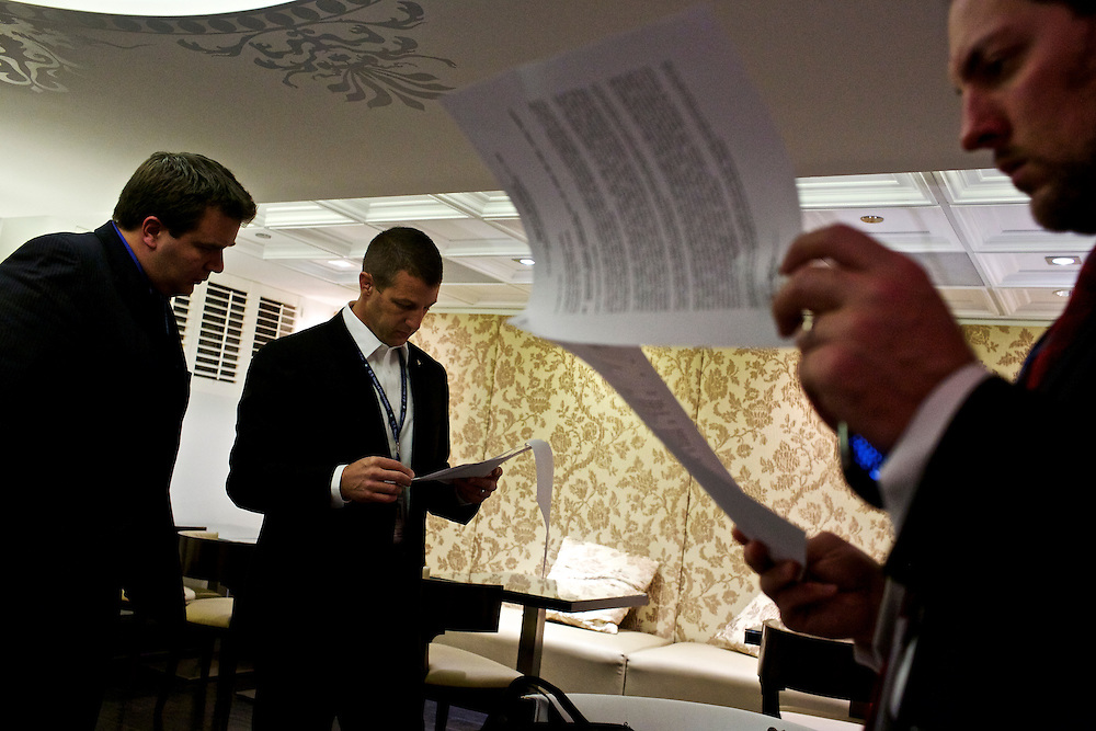 Congressman-elect Markwayne Mullin, from Oklahoma's 2nd District, center, looks over resumes with staff member Tim Ross, left, and advisor Trebor Worthen, right, in the lobby of the Capitol Hill Hotel in Washington, DC on Nov. 29, 2012. Into his second week of orientation, Congressman-elect Mullin is deciding everything from who will be on his staff to what office furniture he will have.