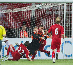GUANGZHOU, CHINA - Wednesday, July 13, 2011: Liverpool's goalkeeper Peter Gulacsi is beaten by Guangdong Sunray Cave's Ricardo for the Chinese side's first goal during the first pre-season friendly on day three of the club's Asia Tour at the Tianhe Stadium. (Photo by David Rawcliffe/Propaganda)