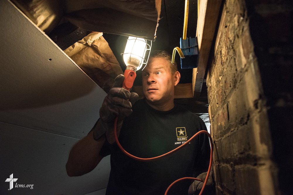 The Rev. Peter M. Burfeind, new domestic missionary and campus pastor at the University of Toledo, works with student Gunther Ruck (not pictured) as they rehab a home as part of their Engineers in Christ project work on Thursday, July 9, 2015, in Toledo, Ohio. LCMS Communications/Erik M. Lunsford