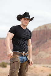 handsome cowboy on a mountain range