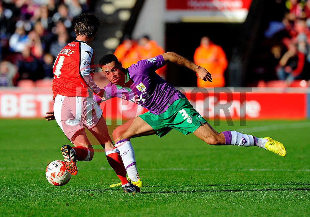 Walsall's James Baxendale takes the ball past Bristol City's Derrick Williams  - Photo mandatory by-line: Joe Meredith/JMP - Mobile: 07966 386802 - 04/10/2014 - SPORT - Football - Walsall - Bescot Stadium - Walsall v Bristol City - Sky Bet League One
