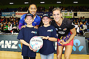 ANZ Future Captains Emma Rose Clelland aged 8 (L) and Eva Forrest-Chambers aged 10 (R) with Maria Tutaia of the Mystics and Leana de Bruin of the Magic. 2015 ANZ Championship, Northern Mystics v WBOP Magic, The Trusts Arena, Auckland, New Zealand. 18 May 2015. Photo: Anthony Au-Yeung / www.photosport.co.nz