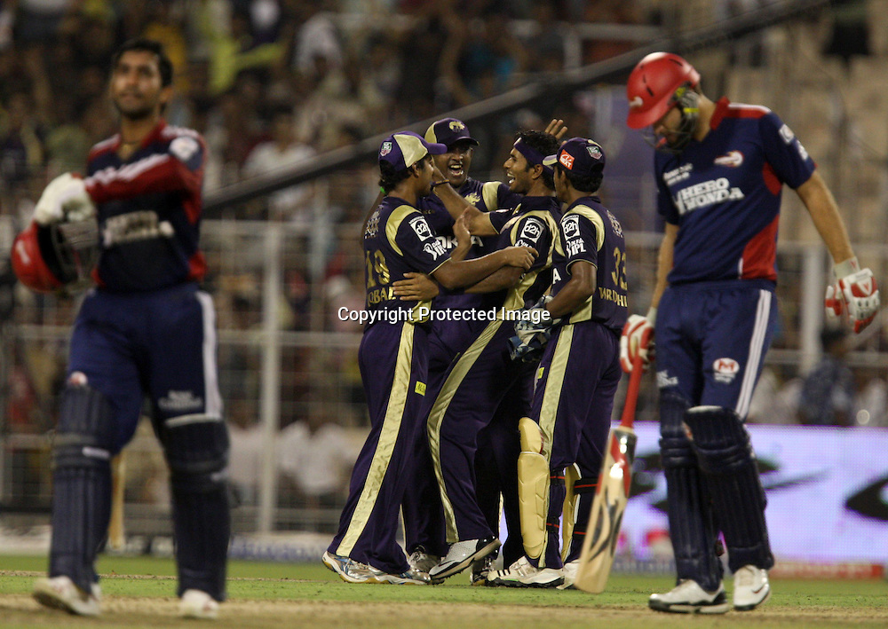 Kolkata Knight Riders Bowler Ashok Dinda Celebrates With Team Dinesh Karthik Wicket During The Indian Premier League - 39th match Twenty20 match |2009/10 season Played at Eden Gardens, Kolkata 7 April 2010 - day/night (20-over match)
