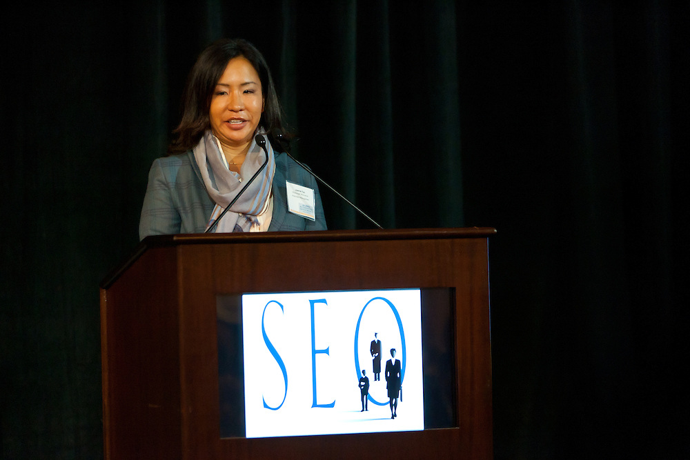 Joanne Yoo, Managing Director, Watermark Alternative Investments Management speaking at the SEO 2nd Annual Alternative Investment Conference held May 17, 2011 at the Essex House Hotel in New York. Organized by Sponsors for Educational Opportunity (SEO), the conference is part of SEO's Alternative Investments Program, which includes the Alternative Investment Fellowship Program (AIFP), an initiative launched in 2009.  The AIFP is an educational program for young professionals from backgrounds traditionally underrepresented in the alternative investments industry.  The AIFP combines workshops, training and mentoring to strengthen Fellows as candidates for positions in private equity and other alternative investments.  The program also improves Fellows' skills as analysts by exploring strategic decisions involved in transactions from the client's point of view.