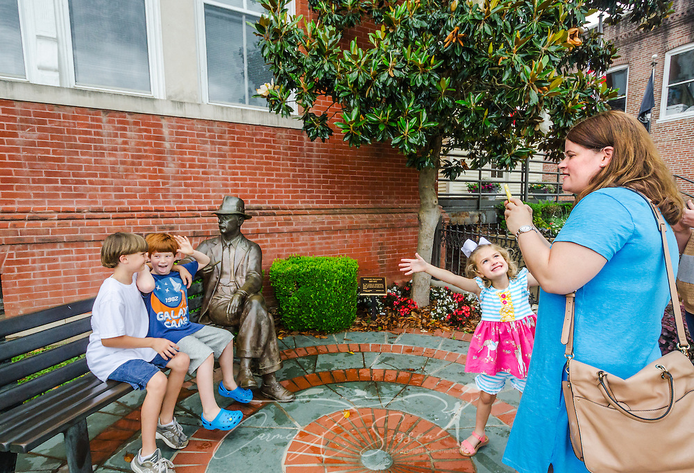 From left, Noah Pressler, Jackson Butler, and Lila Pressler clown around as Laura Pressler waits for a semi-serious moment to photograph the boys with a bronze statue of William Faulkner, May 31, 2015, in Oxford, Mississippi. Laura Pressler and her best friend, Lisa Butler, attended the University of Mississippi and brought the children to see their alma mater. (Photo by Carmen K. Sisson/Cloudybright)