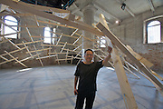 """12th Biennale of Architecture. Arsenale. Wang Shu with his installation (together with Lu Wenyu) """"The decay of a dome"""", 2010."""