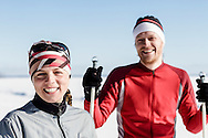 Portrait of happy female and male cross-country skiers.