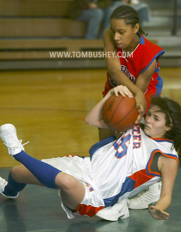 Chester's Juliet Geight falls while battling Goshen's Kassie Keddo-Green duirng a game at S.S. Seward High School in Florida on Nov. 28, 2007.