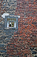 A renovated old brick wall in Montmartre cemetery, Paris