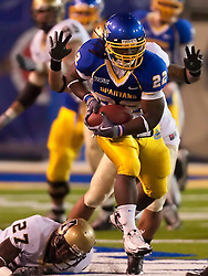 October 10, 2009; San Jose, CA, USA;  San Jose State Spartans running back Lamon Muldrow (22) breaks a tackle from Idaho Vandals safety Isaac Butts (27) during the third quarter at Spartan Stadium. Idaho won 29-25.