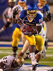 October 10, 2009; San Jose, CA, USA;  San Jose State Spartans running back Lamon Muldrow (22) breaks a tackle from Idaho Vandals safety Isaac Butts (27) during the third quarter at Spartan Stadium. Idaho won 29-25.