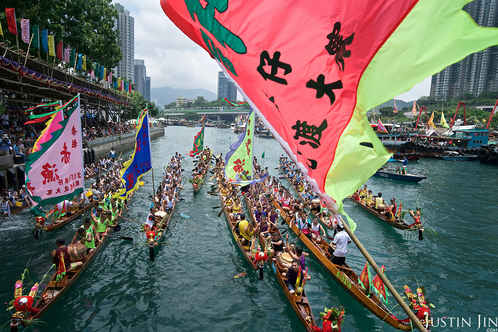 The Dragon Boat race in Hong Kong. The event has been held annually in China for 20 centuries to commemorate the ritual suicide of respected official Qu Yuan. The race became an international event starting in Hong Kong in 1976.