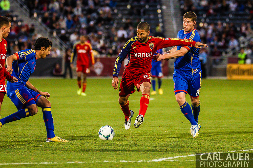 April 6th, 2013 - Real Salt Lake midfielder Enzo Martinez (19) attempts to get a shot off between the defense from Colorado Rapids midfielder Tony Cascio (14) and midfielder Dillon Powers (8) during the second half of the MLS match between Real Salt Lake and the Colorado Rapids at Dick's Sporting Goods Park in Commerce City, CO
