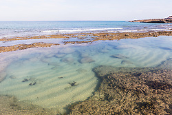 A clear, shallow pool on the shoreline of Macleay Island on the Kimberley coast.