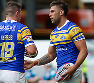 Joel Moon of Leeds Rhinos celebrates scoring his 1st try with team mate Brett Ferres (L) against  Toulouse Olympique during the Betfred Super 8s Qualifiers match at Emerald Headingley Stadium, Leeds<br /> Picture by Stephen Gaunt/Focus Images Ltd +447904 833202<br /> 11/08/2018
