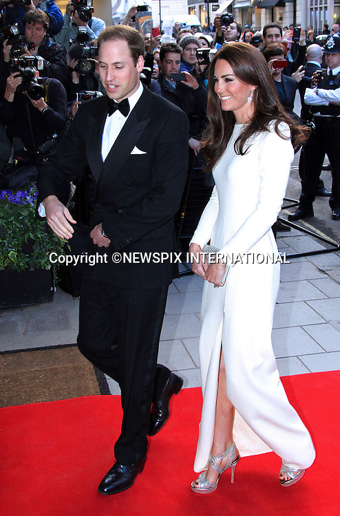 "PRINCE WILLIAM AND CATHERINE, Duchess of Cambridge.wearing in a full length cream outfit with a slit to the side, attend the Thirty Club Dinner at the Claridge's Hotel, London_08/05/2012.Mandatory Credit Photo: ©SB/NEWSPIX INTERNATIONAL..**ALL FEES PAYABLE TO: ""NEWSPIX INTERNATIONAL""**..IMMEDIATE CONFIRMATION OF USAGE REQUIRED:.Newspix International, 31 Chinnery Hill, Bishop's Stortford, ENGLAND CM23 3PS.Tel:+441279 324672  ; Fax: +441279656877.Mobile:  07775681153.e-mail: info@newspixinternational.co.uk"