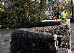©London News pictures... 17/11/2010. Inspectors watch the build up of flotsam against a bridge in Lostwithie which they believe is in danger of collapse. The River Fowey burst its banks at Lostwithie in Cornwall. today (Wednesday). Some people have been left trapped in their cars and homes in parts of Cornwall as heavy rain and gale-force winds caused flooding and disruption.Photo Caption should read Mark Bowes/London News Pictures