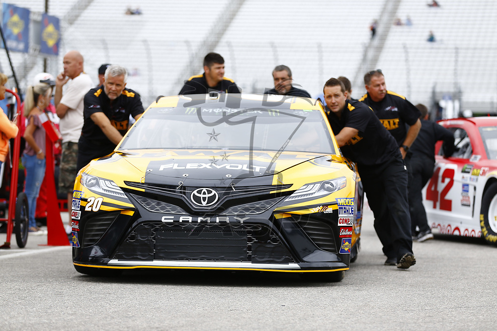 July 14, 2017 - Loudon, NH, USA: The crew of Matt Kenseth (20) pushes his car through the garage before practice for the Overton's 301 at New Hampshire Motor Speedway in Loudon, NH.