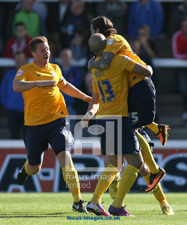 Picture by Paul Gaythorpe/Focus Images Ltd +447771 871632<br /> 28/09/2013<br /> Oxford United players congratulate Ryan Williams on scoring the first goal against Hartlepool United during the Sky Bet League 2 match at Victoria Park, Hartlepool.