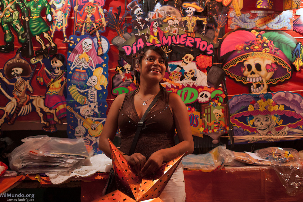 A young woman sells traditional day of the dead crafts at Naucalpan's municipal market. Naucalpan de Juárez, México, México. Oct. 19, 2012.