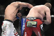 """LONDON, ENGLAND, OCTOBER 2010: Vinicius Queiroz (left) lands an overhead right on Rob Broughton during """"UFC 120: Bisping vs. Akiyama"""" inside the O2 Arena in Greenwich, London"""