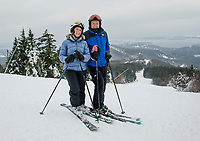 Nancy and Bob Howes visiting from Cape Cod take in great early season conditions as they make their first turns of the season at Gunstock on Tuesday afternoon.  (Karen Bobotas/for the Laconia Daily Sun)