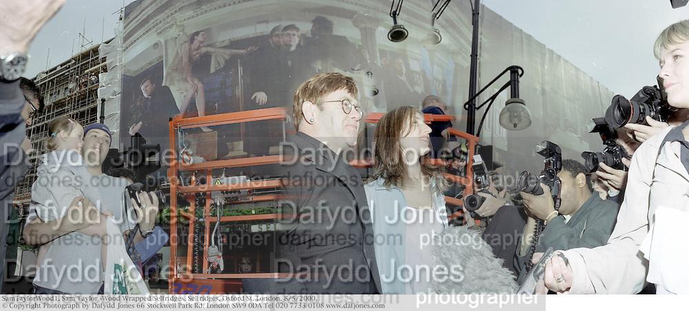 sir Elton John; Sam Taylor Wood Wrapped Selfridges. 2000, SamTaylorWood1. Sam Taylor -Wood Wrapped Selfridges. Selfridges, Oxford St. London. 8/5/2000.<br /> &copy; Copyright Photograph by Dafydd Jones 66 Stockwell Park Rd. London SW9 0DA Tel 020 7733 0108 www.dafjones.com