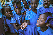 Haitian schoolgirls know that this mix of medications, taken annually, will prevent lymphatic filariasis, or elephantiasis, a disease caused by mosquito borne parasites entering the lymph system.