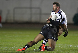 Scotland's Ben Hellewell is tackled by New Zealand's Manu Ma'u, during the 4 Nations match at the Zebra Claims Stadium, Workington.