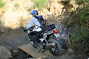 "Riders had to cross makeshift bridges during ""The Pit"" competition at the 2009 Rawhyde Adventure Rider's Challenge in Castaic, CA."