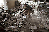 Iraq, Kurdistan: Peshmerga soldiers searches among rubbles in a heavily destroyed building in Sinjar. <br />