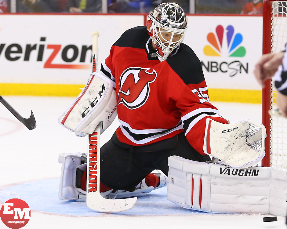 Mar 31, 2014; Newark, NJ, USA; New Jersey Devils goalie Cory Schneider (35) makes a pad save during the second period of their game against the Florida Panthers  at Prudential Center.