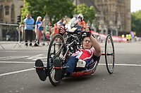 Competitors in the Prudential RideLondon Handcycle Classic pass through Parliament Square on their way to the finish on The Mall. Prudential RideLondon is the world's greatest festival of cycling, involving 95,000+ cyclists – from Olympic champions to a free family fun ride - riding in five events over closed roads in London and Surrey over the weekend of 1st and 2nd August 2015.<br /> <br /> Photo: Thomas Lovelock for Prudential RideLondon<br /> <br /> See www.PrudentialRideLondon.co.uk for more.<br /> <br /> For further information: Penny Dain 07799 170433<br /> pennyd@ridelondon.co.uk