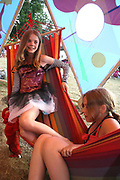 Two girls lying in a hammock at the Workhouse Festival, Wales, 2006
