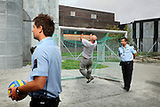 Guards (left and right) are regularly spending time with inmates in various open areas where games like soccer, volleyball and basketball are organised in mixed teams of inmates, guards and other prison staff in the luxurious Halden Fengsel, (prison) near Oslo, Norway.