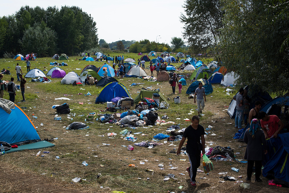 A field houses a tent city in between two closed border crossings on September 17, 2015 in Horgos, Serbia.