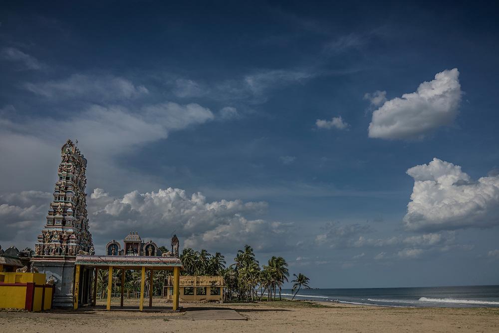 The Periyanayagi Amman Temple on an idyllic beach in Tamil Nadu.  Tiruchchepuram, Tamil Nadu, India.