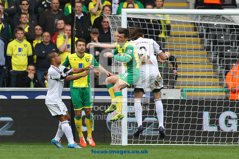 Jonny Howson of Norwich and Michu of Swansea in action during the Barclays Premier League match at the Liberty Stadium, Swansea<br /> Picture by Paul Chesterton/Focus Images Ltd +44 7904 640267<br /> 29/03/2014