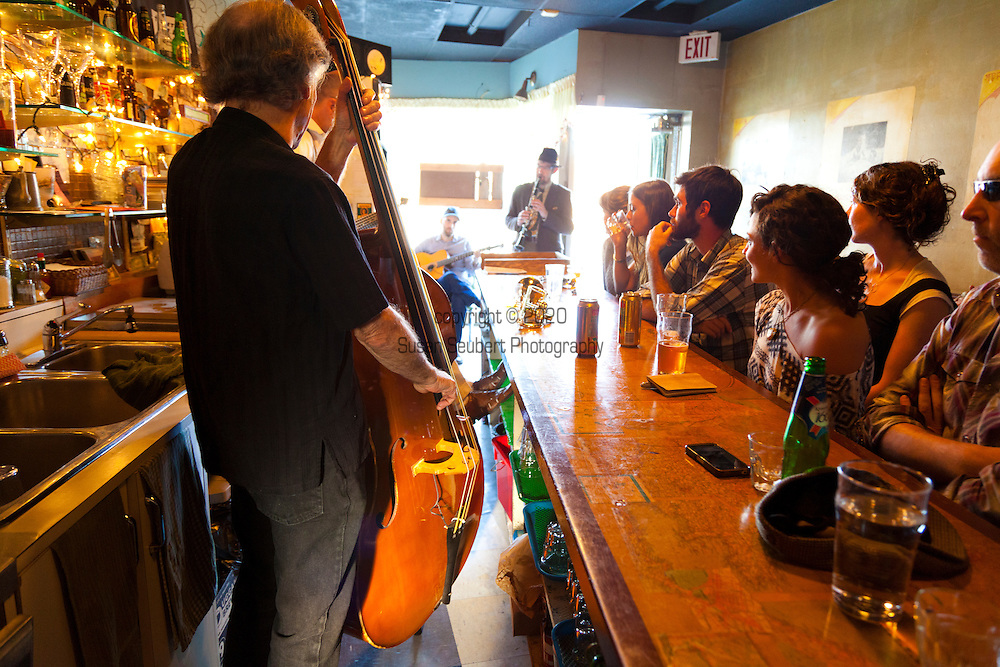 The Communist's Daughter in Little Portugal at Dundas Street West and Ossington.  On Saturday afternoons from 4-7pm Michael Louis Johnson and the Red Rythm band play behind the bar while serving drinks.