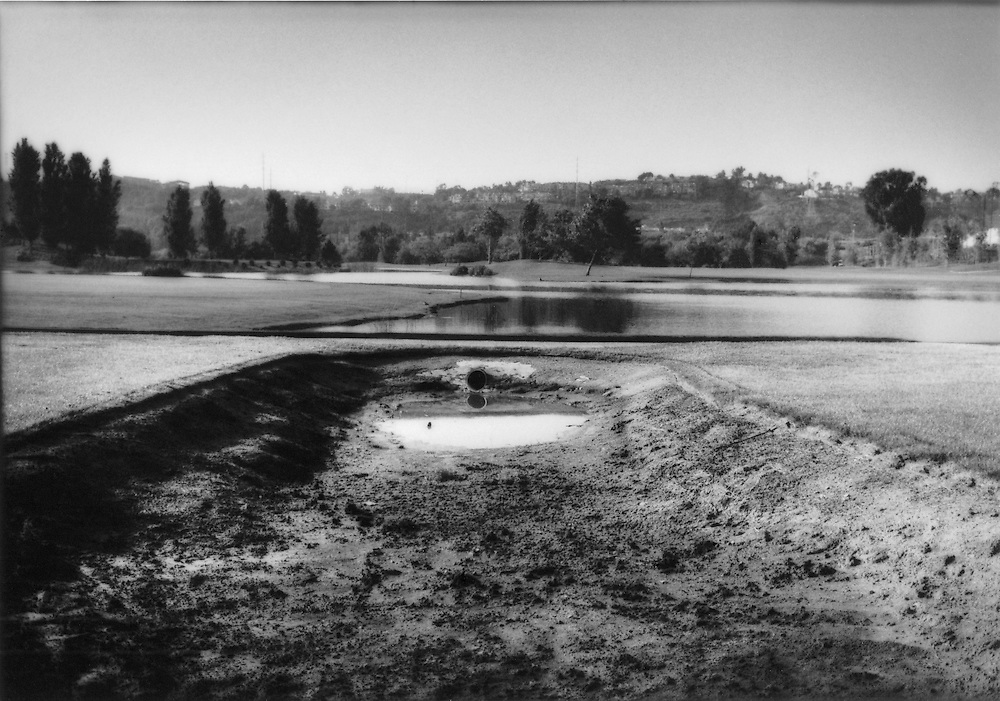 Two ponds, one dried out, on a lush golf course in Mission Valley, San Diego, California, USA.