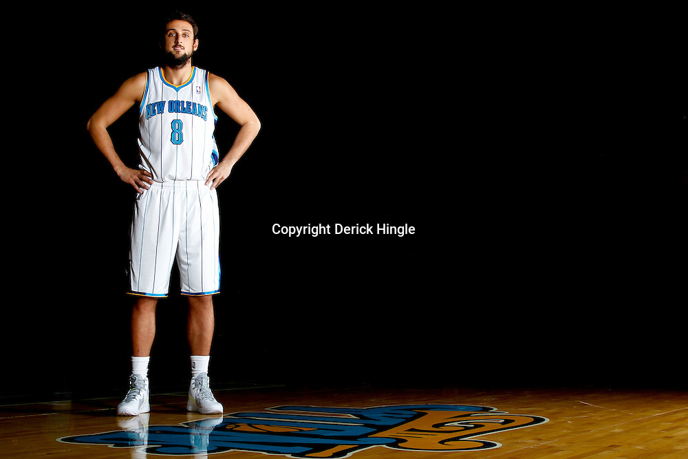 December 14, 2011; New Orleans, LA, USA; New Orleans Hornets guard Marco Belinelli (8) poses for a photo during Media Day at the New Orleans Arena.   Mandatory Credit: Derick E. Hingle-US PRESSWIRE