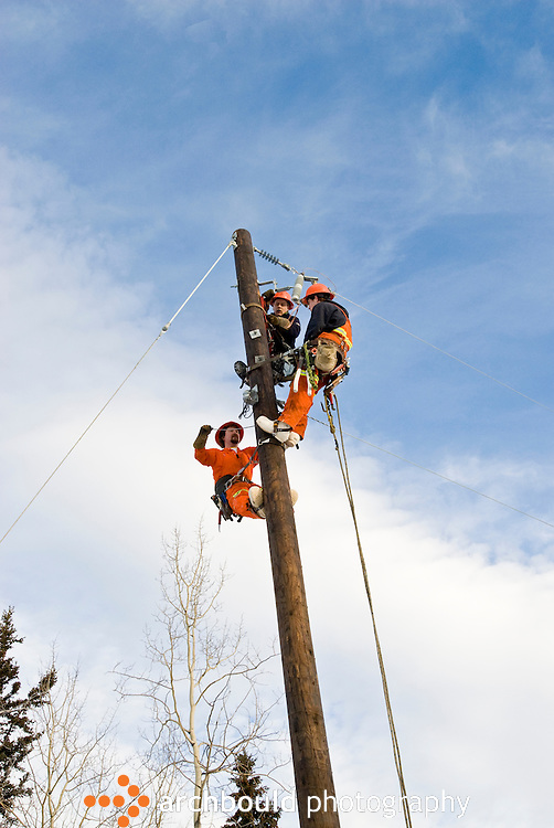 Linesmen working on power lines in Yukon, Canada.<br /> <br /> NOT IN YOUR BUDGET? Contact Cathie for a price specific to your project.