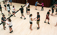 Students learn to ballroom dance in the Festival Room at Sunburst Festival at Memorial Union in 2014.