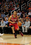 Dec. 10 2010; Phoenix, AZ, USA; Portland Trailblazers guard Brandon Roy (7) handles the ball during the first half against the Phoenix Suns at the US Airways Center.  The Trailblazers defeated the Suns 101-94. Mandatory Credit: Jennifer Stewart-US PRESSWIRE.