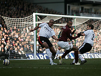 Photo: Lee Earle.<br /> Fulham v Arsenal. The Barclays Premiership. 04/03/2006. Arsenals' Thierry Henry (C) battles with Zat Knight (L) and Moritz Volz.