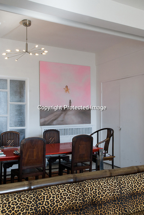 Meg Maggio's Beijing home. In the leaving room a painting by Chinese artist Ma Liuming