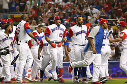 March 11, 2017 - Miami, FL, USA - The Dominican Republic's Nelson Cruz (23) is congratulated by teammates after hitting a three-run home run during the eighth inning against the United States in a World Baseball Classic first round Pool C game at Marlins Park in Miami on Saturday, March 11, 2017. The Dominican Republic won, 7-5. (Credit Image: © David Santiago/TNS via ZUMA Wire)