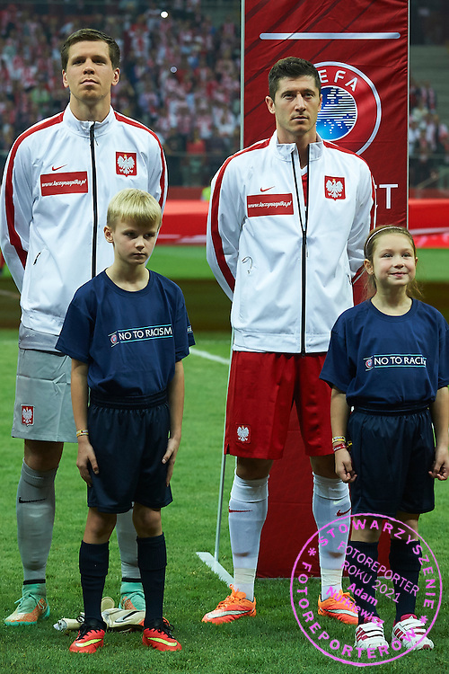 Poland's goalkeeper Wojciech Szczesny (L) and Robert Lewandowski stand while national anthem during the EURO 2016 qualifying match between Poland and Germany on October 11, 2014 at the National stadium in Warsaw, Poland<br /> <br /> Picture also available in RAW (NEF) or TIFF format on special request.<br /> <br /> For editorial use only. Any commercial or promotional use requires permission.<br /> <br /> Mandatory credit:<br /> Photo by &copy; Adam Nurkiewicz / Mediasport