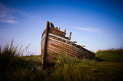 Abandoned fishing boat, Blakeney, North Norfolk Coast, England, UK.