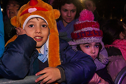 Trafalgar Square, London, December 16th 2014.  London's Jewish community celebrates Chanukah in the Square which marks the beginning of the Jewish festival of lights. The annual event is presented by the Jewish Leadership Council, London Jewish Forum and Chabad and is supported by the Mayor of London.  PICTURED: Children watch the performances on stage.